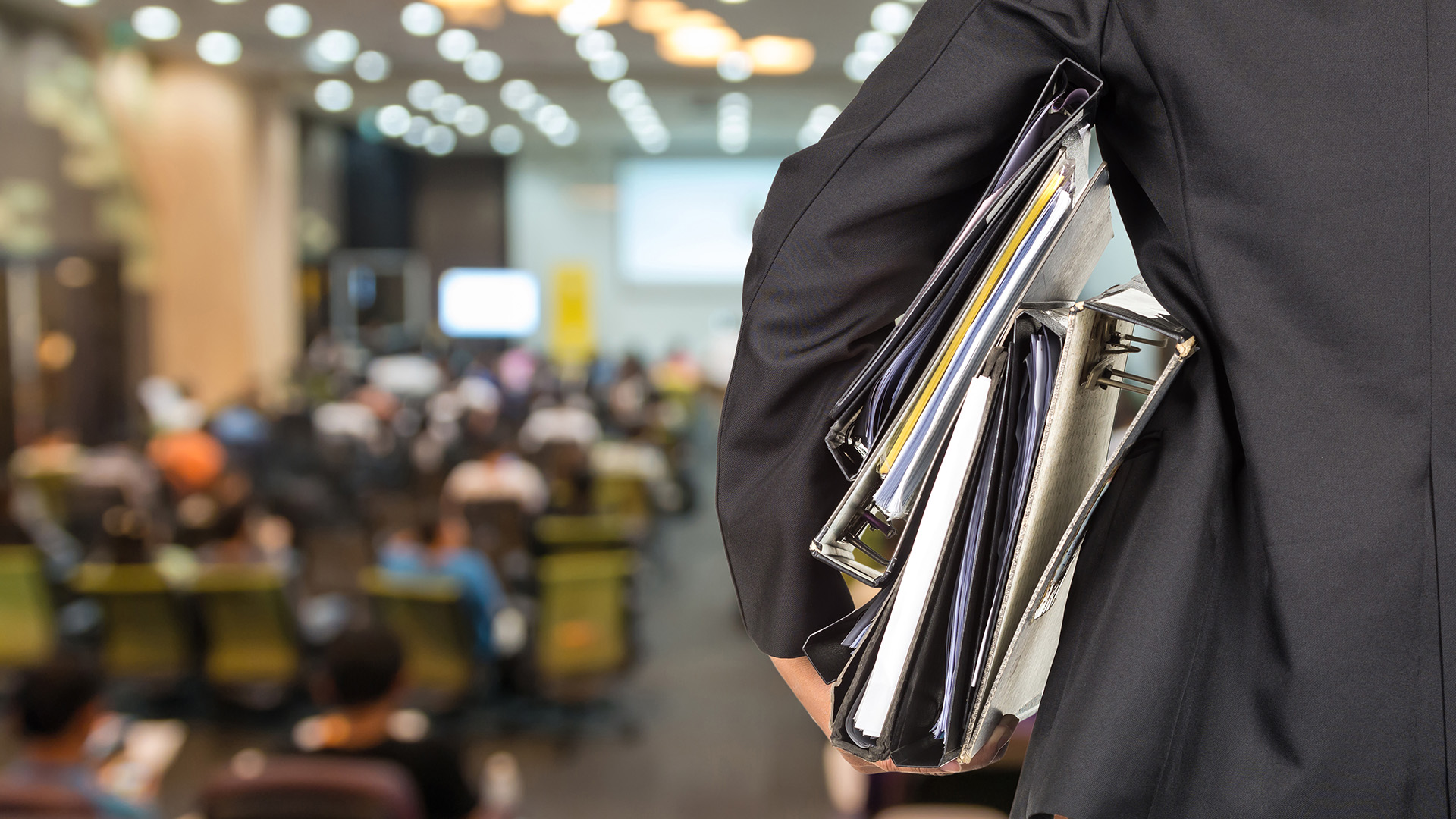 Businessman is holding many document folders